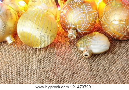 golden christmas toys and balls  on burlap