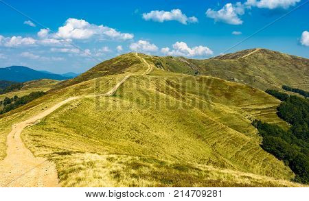 Footpath Through The Grassy Hills Of Mountains