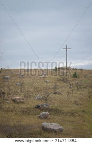 Peasant Wooden Cross On The Mountain Near The River Bank, Lake.