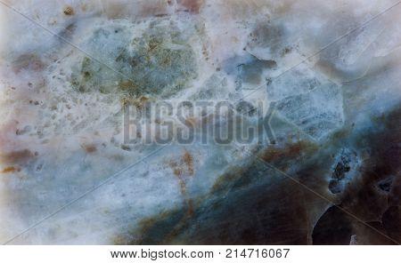 Plagioclase feldspar silicate mineral stone with Beryl beryllium aluminium cyclosilicate. White green brown colored stony background macro view