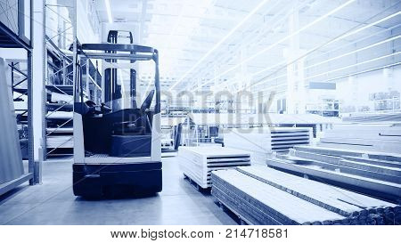 warehouse banner. forklift in large modern warehouse. logistics concept