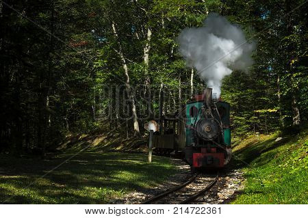 BOOTHBAY ME - SEPTEMBER 8 2017: Henschel & Son engine whistles by releasing steam at whistle sign. Built in 1934 this steam train was built for use on the narrow gauge tracks along the Maine coast.