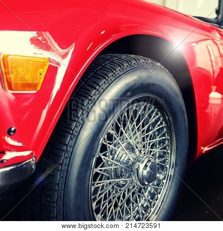 wire wheel on red car