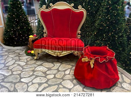 Santa Claus seat and bag. Santa categorizing children according to their behavior and deliver presents to the well-behaved and coal to the misbehaved children on Christmas Eve.