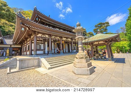 Kamakura, Japan - April 23, 2017: tourists in front of Kannon-do or Main hall of Hase-dera Temple in Kamakura. Hase-dera Buddhist temple is famous for housing a massive wooden statue of Kannon.