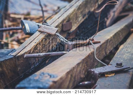 An Old Wooden Boat With Oars, Rope And Other Gear. Closed Oars