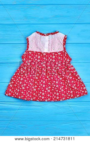 Beautiful vintage baby-girl dress. Natural childs red sleeveless dress on sale. Little girls summer clothing, top view.