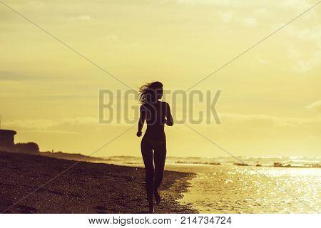 Pretty Girl In Yellow Swimsuit Running On Sandy Beach