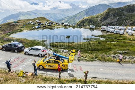 Col de la Croix de Fer France - 25 July 2015: BIC caravan driving on the road to the Col de la Croix de Fer in Alps during the stage 20 of Le Tour de France 2015. BIC is a global company which offers an extensive line of writing and office tools.