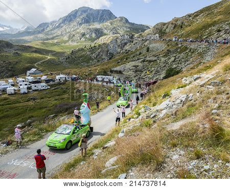 Col de la Croix de Fer France - 25 July 2015: Teisseire caravan driving on the road to the Col de la Croix de Fer in Alps during the stage 20 of Le Tour de France 2015. Teisseire produces fruit juices and syrups for the food service industry.