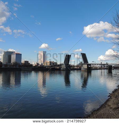 Open draw bridge on the Willamette River in Portland Oregon in sunshine
