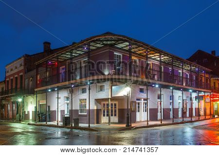 NEW ORLEANS - JUN. 1, 2017: Historic Buildings at the corner of Bourbon Street and St Peter Street in French Quarter at night in New Orleans, Louisiana, USA.
