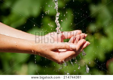 Woman Is Washing Hand Outdoors.  Young Hands With Water Splash, Selective Focus. Health Concept