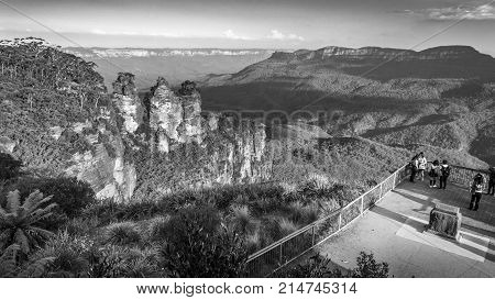 Sydney, Australia - Apr 18, 2017: Three Sisters rock formation at Echo Point. This wilderness area forms part of the Blue Mountains National Park. Image features the escarpment and Jamison Valley. B&W.