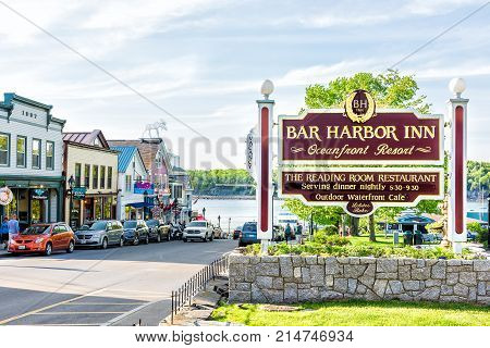 Bar Harbor, Usa - June 8, 2017: Oceanfront Resort Inn Sign With Waterfront Dining And Harbor In Down