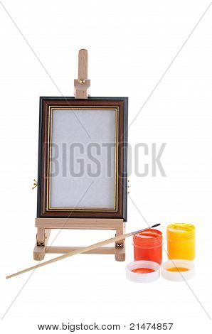 Easel, paints and bruch.