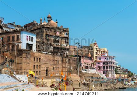 VARANASI INDIA - MARCH 14 2016: Wide angle picture of amazing architecture Ganga Mahalgha Ghat in Ganges River during day time in Varanasi India.