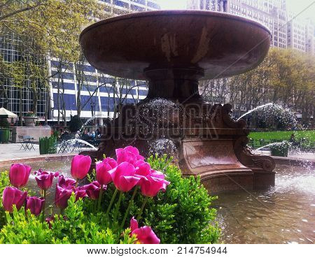 Springtime shot of Josephine Shaw Lowell memorial fountain in Bryant Park, New York City. 6th Avenue and 42nd Street.