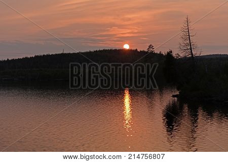 Orange Water and Skies at Sunset on Little Saganaga Lake in the Boundary Waters in Minnesota