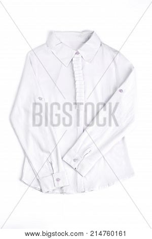 New cotton white girls blouse. Girls white long sleeve shirt isolated on white background. Classic girls white blouseon sale.