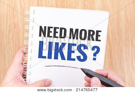 Need More Likes ? Word On White Ring Binder Notebook With Hand Holding Pencil On Wood Table,online D