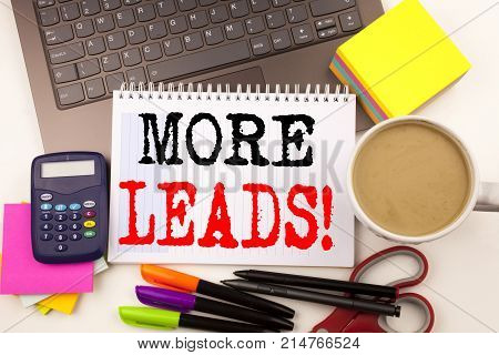 Word Writing More Leads In The Office With Surroundings Such As Laptop, Marker, Pen, Stationery, Cof