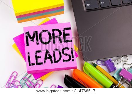 Writing Text Showing More Leads Made In The Office With Surroundings Such As Laptop, Marker, Pen. Bu