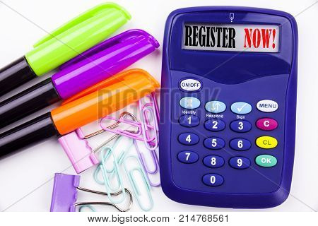 Writing Word Register Now Text In The Office With Surroundings Such As Marker, Pen Writing On Calcul