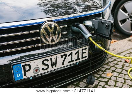 Berlin, October 2, 2017: A modern electric car is being charged at a special place for charging electric vehicles. Eco-friendly mode of transport has become widespread in Europe