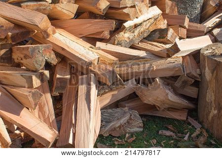 Natural wooden background closeup of chopped firewood. Chopped firewood on a stack. Pile firewood prepared for fireplace