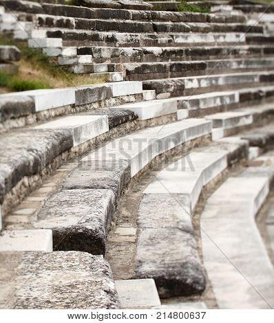 Seats at the ancient amphitheater with steps