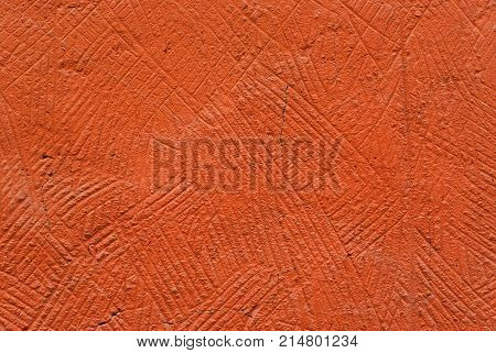 background, texture: orange, deliberately coarse plastered wall of a building closeup