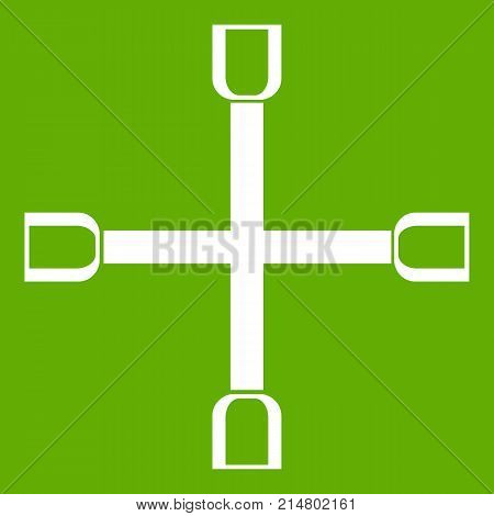 Wheel wrench cross icon white isolated on green background. Vector illustration
