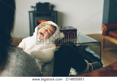 Newborn Baby Boy Crying On His Mother's Arms