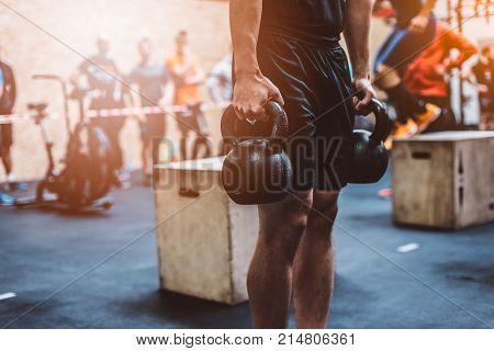 Man Training With Kettlebell In Functional Fitness Gym