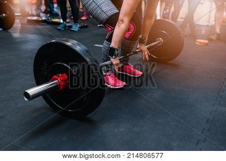 Woman Preparing To Barbell Deadlift