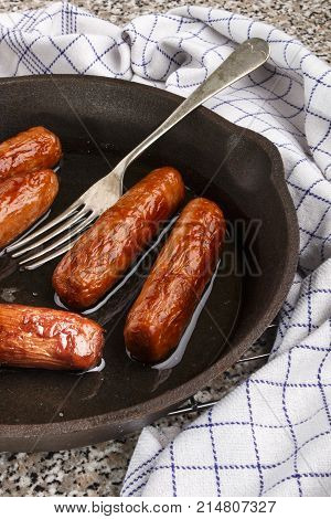 grilled irish pork sausages in a cast iron pan
