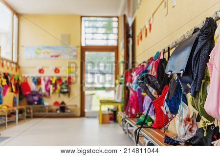 Empty hallway in the school backpacks and bags on hooks bright recreation room