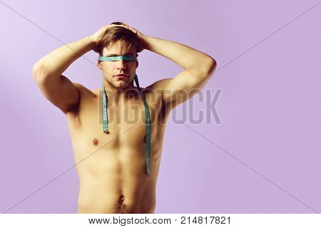 Sports Regime Idea: Man With Tied Eyes With Measuring Tape
