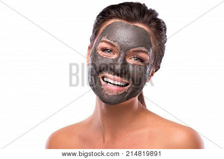 Beautiful Woman With A Clay Or A Mud Mask On Her Face