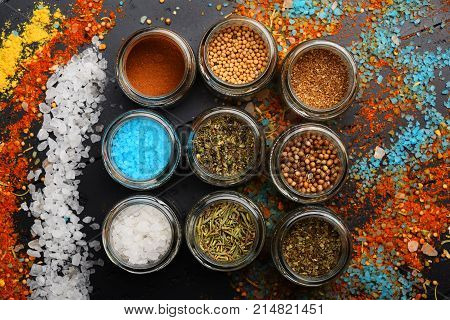 Set Of Spices On Dark Grey Background. Glass Jars