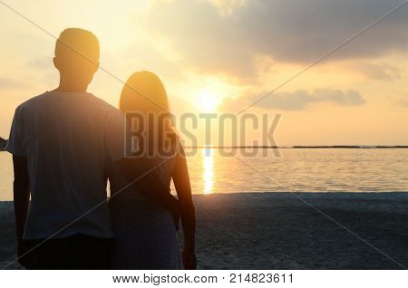 Loving couple on the beach. Couple in love. Maldives vacation. Lifestyle. Travel vacation love romance sunrise.