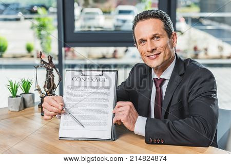 Lawyer Pointing At Contract