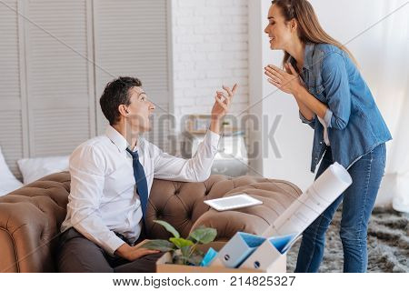 Important talk. Friendly emotional couple looking interested while being at home and having an important conversation about their future