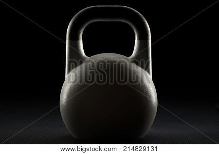 Single backlit competition kettlebell silhouette on a black background with text / writing / copy space on kettlebell