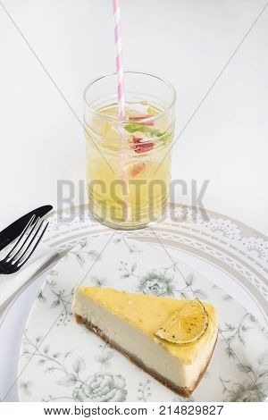 very delicious lemon cheese cake with lemon pieces on it