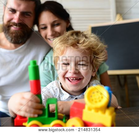 Love And Family Games Concept. Mom, Dad And Boy