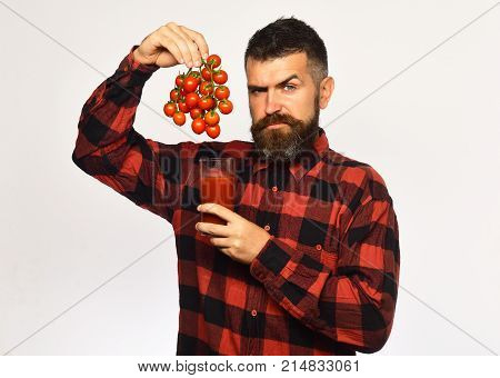 Farmer With Concerned Face Shows Bunch Of Red Cherry Tomatoes