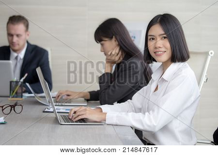 Asian Woman have a meeting with team for Business present. Woman working at meeting room with team. People working concept. 20-30 years old.