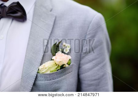 Details Of Groom Suit: Boutonniere Of Fresh White Rose And Stylish Bow Tie
